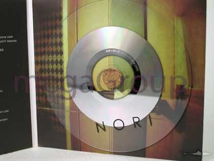 Cork hub CD Packaging shown with clear disc